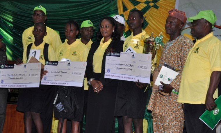 Winners display their gift as they pose with the wife of Ogun State governor, Mrs Olufunso Amosun